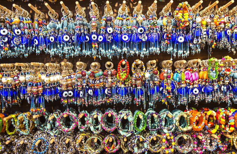 Lucky charms on display. Lucky charms and beads from the display of a local traditional shop stock photography