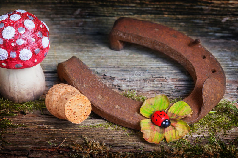 Lucky charms, lucky symbols. On old wood royalty free stock photos