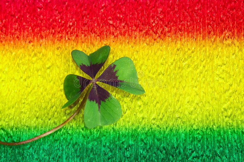 Lucky clover on colorful crepe paper. The picture shows lucky clover on colorful crepe paper stock images