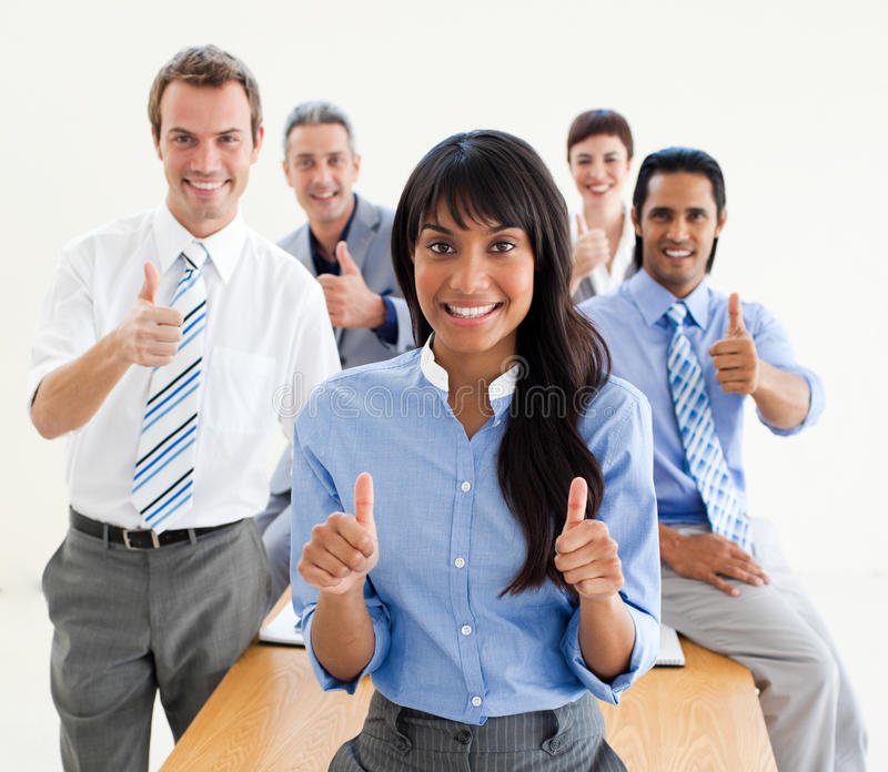 Lucky co-workers with thumbs up stock images