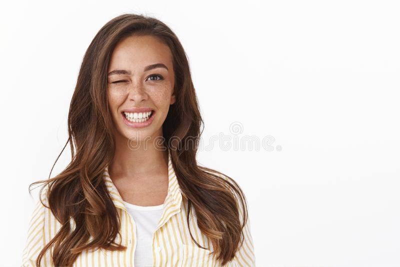 Lucky girl feeling determined day gonna be perfect. Upbeat optimistic caucasian woman wink and smiling, encourage team stock images