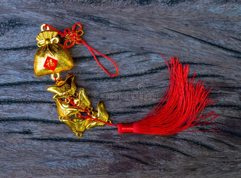 Lucky knot for Chinese new year celebrations theme decoration traditional on wooden background royalty free stock photography