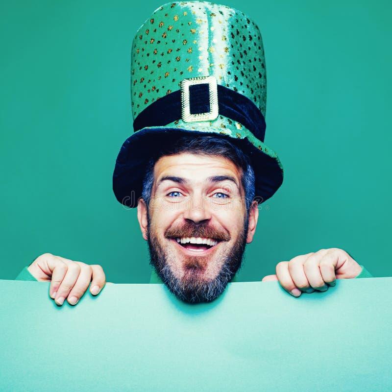 Lucky Patricks day. Man on green background celebrate St Patricks Day. Man in Saint Patrick`s Day leprechaun party hat royalty free stock photo