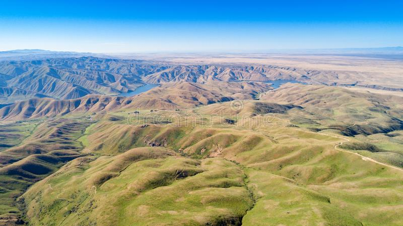 Lucky Peak reservoir at the base of mountain foot hills in south stock images