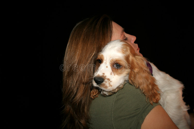 Lucky Puppy. Girl with green shirt holding puppy royalty free stock photography
