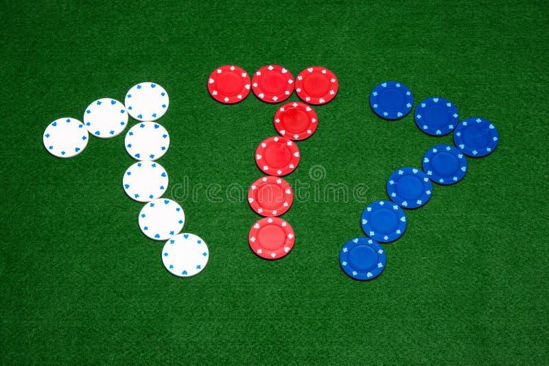Lucky Seven. 777 Poker Chips Sign on Green Felt stock photo