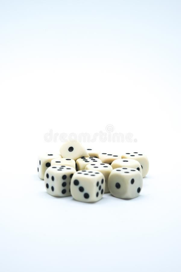White dice on white background, thematic luck and games of chance. White dice with black dots on white background, thematic luck and games of chance royalty free stock photography