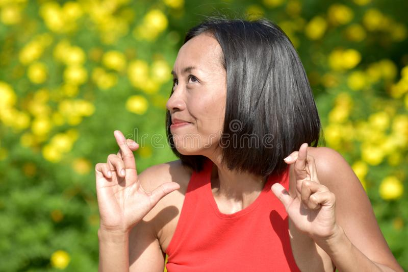 Lucky Youthful Filipina Person. An attractive and asian person royalty free stock image