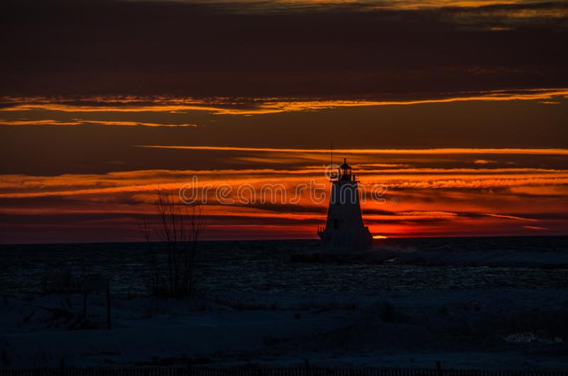 Ludington Light Silhouette at Sunset. Silhouette of Ludington, Michigan`s, North Breakwater Light at sunset stock image