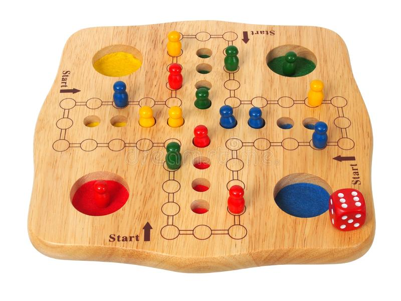 Ludo board game. With die and pieces stock images