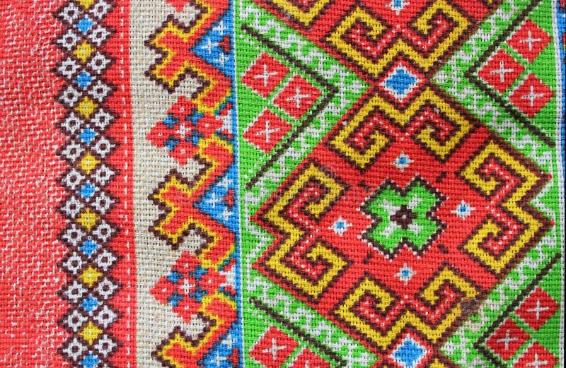 Ludowy tekstylny ornament jaskrawi kolory, składający się wzory geometryczni kształty i linie obraz stock