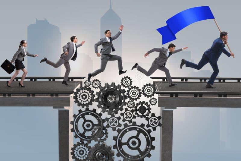 Ludzie biznesu krzyżuje most z cogwheels obraz stock