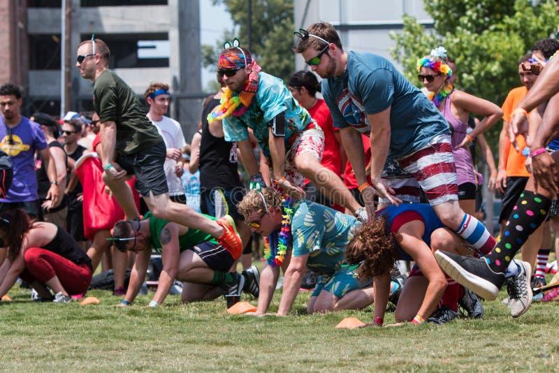 Ludzie sztuka skoku żaby Przy Atlanta dnia sportu wydarzeniem fotografia royalty free