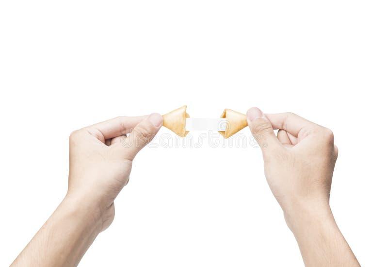 Ludzka ręka otwiera pomyślności ciastka z pustym papierem wśrodku go obrazy royalty free