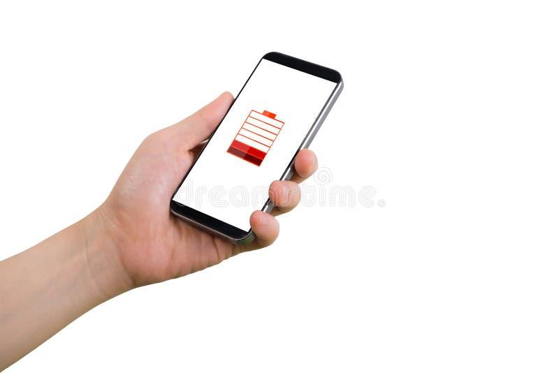 Ludzki ręka chwyta smartphone, pastylka, telefon komórkowy z wirtualną niską bateryjną status ikoną na ekranie fotografia stock