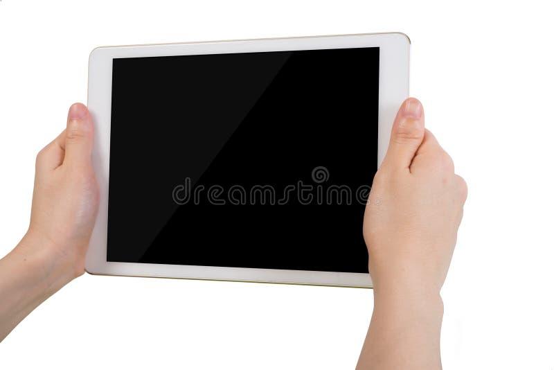 Ludzkiego ręka chwyta pustego ekranu bezpłatna pastylka na odosobnionym białym tle fotografia stock