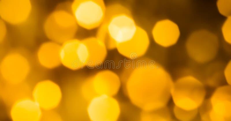 Lueur d'or fascinant et scintillement brillants, fond de luxe de vacances images stock