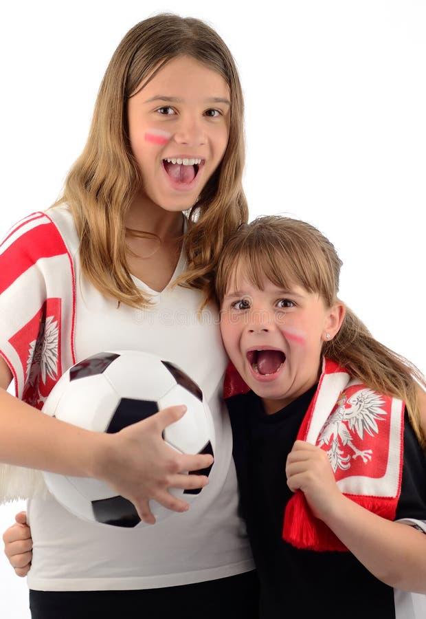 luftar skrikigt barn för fotboll arkivbild