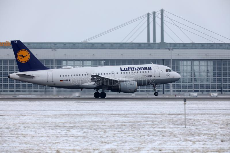 Lufthansa Airbus A319-100 D-AILA in Munich Airport. Lufthansa Airbus A319-100 D-AILA landing in Munich Airport, MUC. Winter time with snow on runways royalty free stock photography