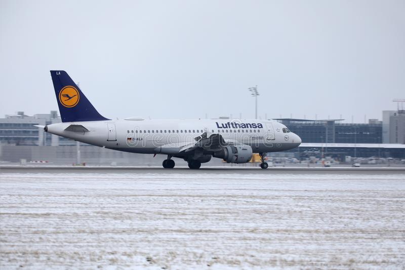 Lufthansa Airbus A319-100 D-AILA in Munich Airport. Lufthansa Airbus A319-100 D-AILA landing in Munich Airport, MUC. Winter time with snow on runways stock images