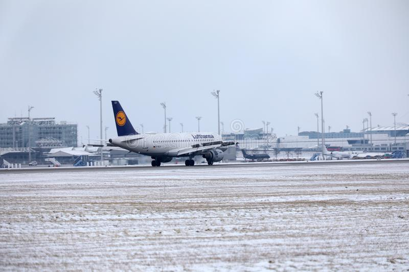 Lufthansa Airbus A319-100 D-AILA in Munich Airport. Lufthansa Airbus A319-100 D-AILA landing in Munich Airport, MUC. Winter time with snow on runways royalty free stock image