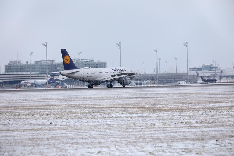 Lufthansa Airbus A319-100 D-AILA in Munich Airport. Lufthansa Airbus A319-100 D-AILA landing in Munich Airport, MUC. Winter time with snow on runways stock photo