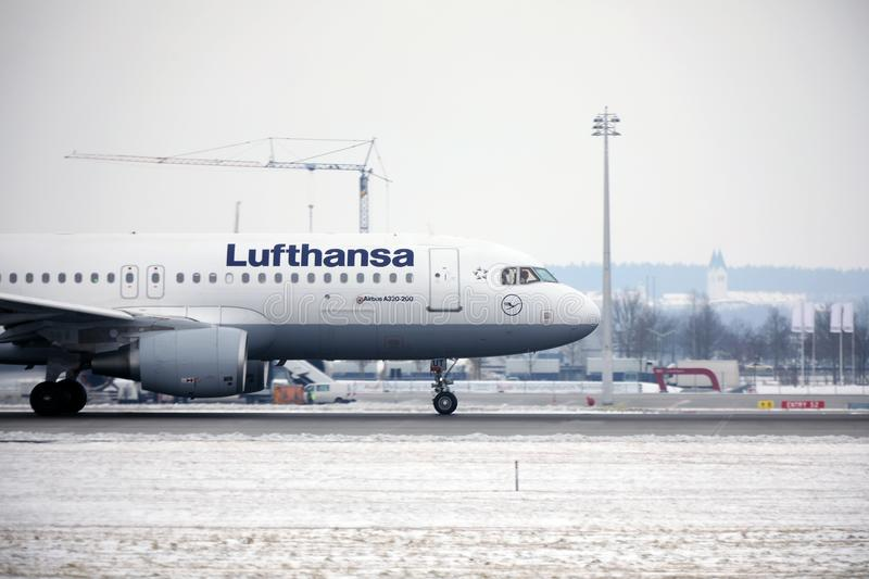 Lufthansa Airbus A319-100 D-AILA in Munich Airport. Lufthansa Airbus A319-100 D-AILA landing in Munich Airport, MUC. Winter time with snow on runways stock photography