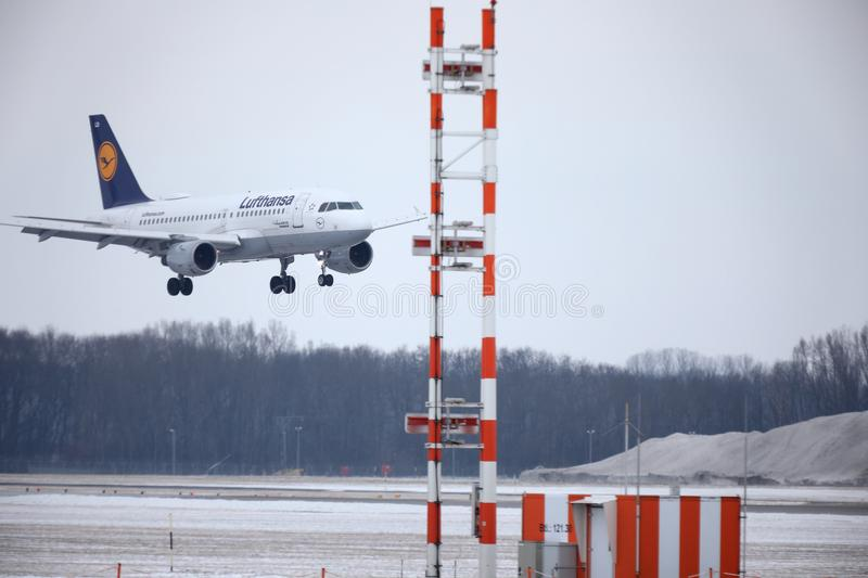 Lufthansa Airbus A319-100 D-AILD in Munich Airport MUC. Winter time with snow on runway. Jet landing stock photo