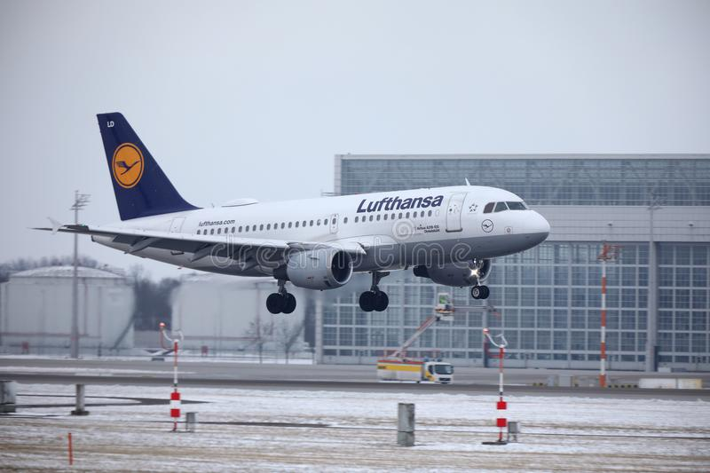 Lufthansa Airbus A319-100 D-AILD in Munich Airport MUC. Winter time with snow on runway. Jet landing royalty free stock image