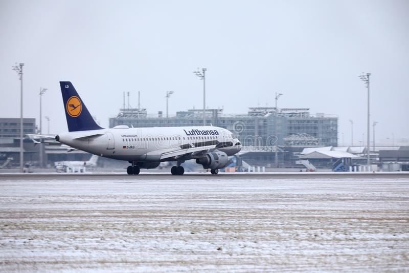 Lufthansa Airbus A319-100 D-AILD in Munich Airport MUC. Winter time with snow on runway. Jet landing stock image