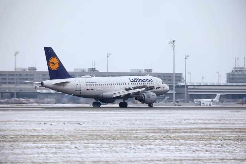 Lufthansa Airbus A319-100 D-AILD in Munich Airport MUC. Winter time with snow on runway. Jet landing stock images