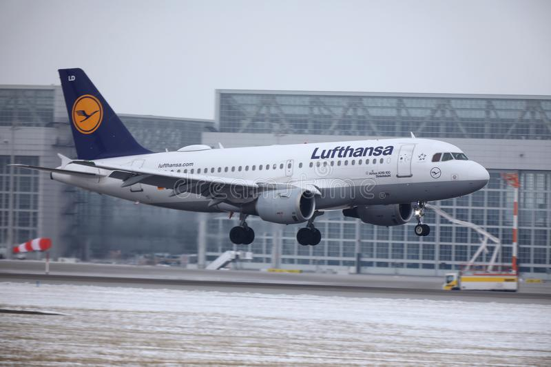 Lufthansa Airbus A319-100 D-AILD in Munich Airport MUC. Winter time with snow on runway. Jet taking off royalty free stock photo