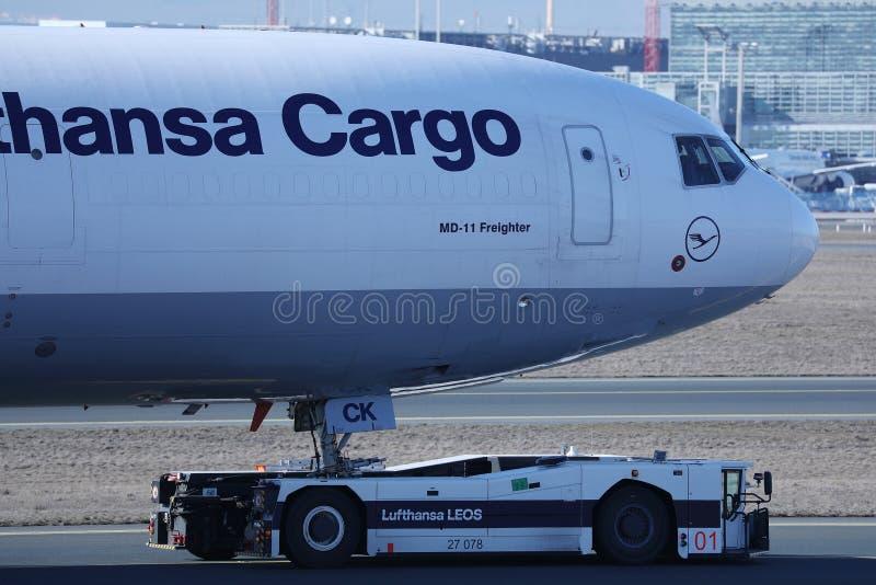 Lufthansa Cargo plane towed being in Frankfurt Airport. Lufthansa Cargo plane being taxiing in Frankfurt Airport, FRA stock image