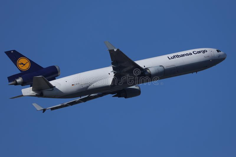 Lufthansa Cargo plane flying up in the sky. Lufthansa Cargo plane shipping, flying to destination stock photos
