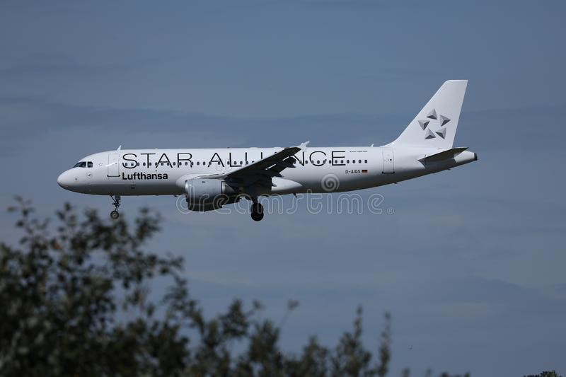 Lufthansa Star Alliance plane approaching airport. Lufthansa jet flying up in the sky royalty free stock photography