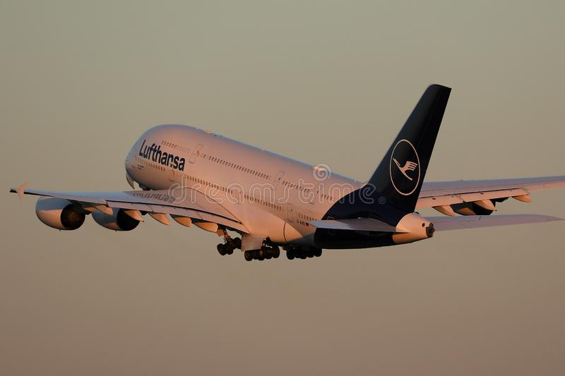 Lufthansa plane Airbus A380 flying up in the sky. Lufthansa A380 super jumbo, new livery royalty free stock images
