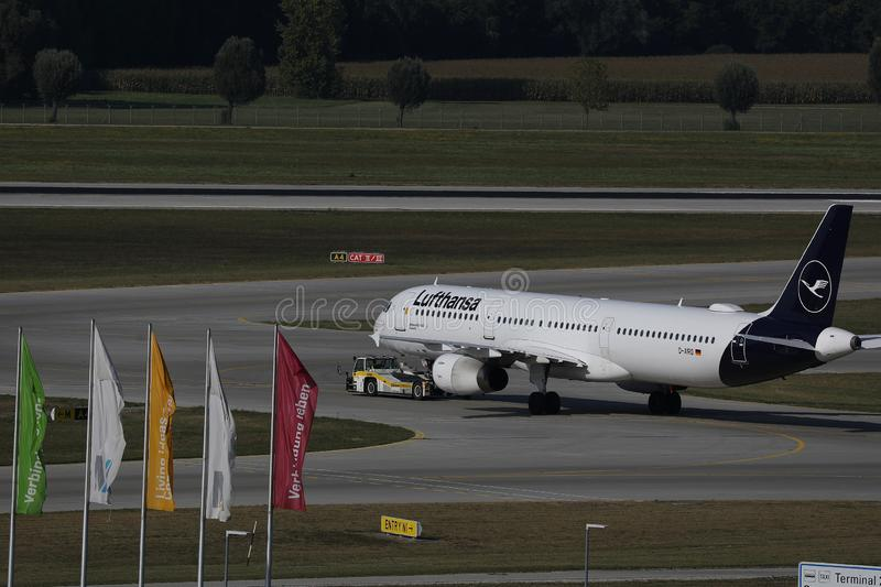 Lufthansa plane being towed. In Munich Airport MUC royalty free stock photo