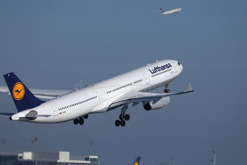 Lufthansa plane flying up in the sky. Lufthansa passenger aircraft taking off from airport stock photography