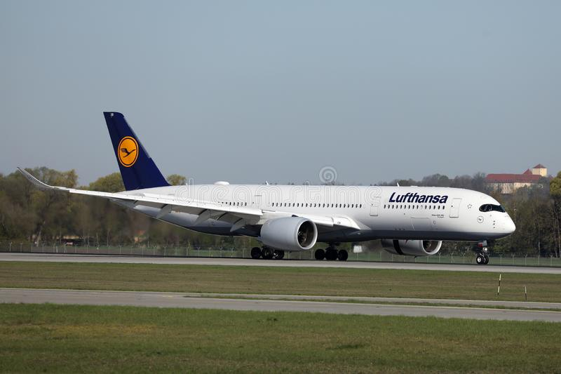 Lufthansa plane taxiing on Munich Airport, MUC. Lufthansa planes taking off from Munich Airport MUC royalty free stock photo