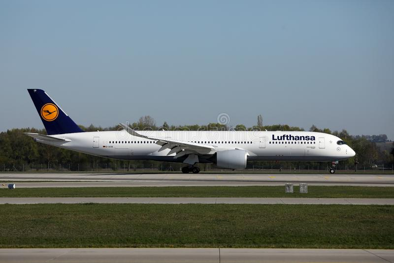 Lufthansa plane taxiing on Munich Airport, MUC. Lufthansa planes taking off from Munich Airport MUC stock photo
