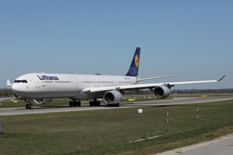 Lufthansa A340 plane taxiing on Munich Airport, MUC. Lufthansa planes taking off from Munich Airport MUC royalty free stock photos