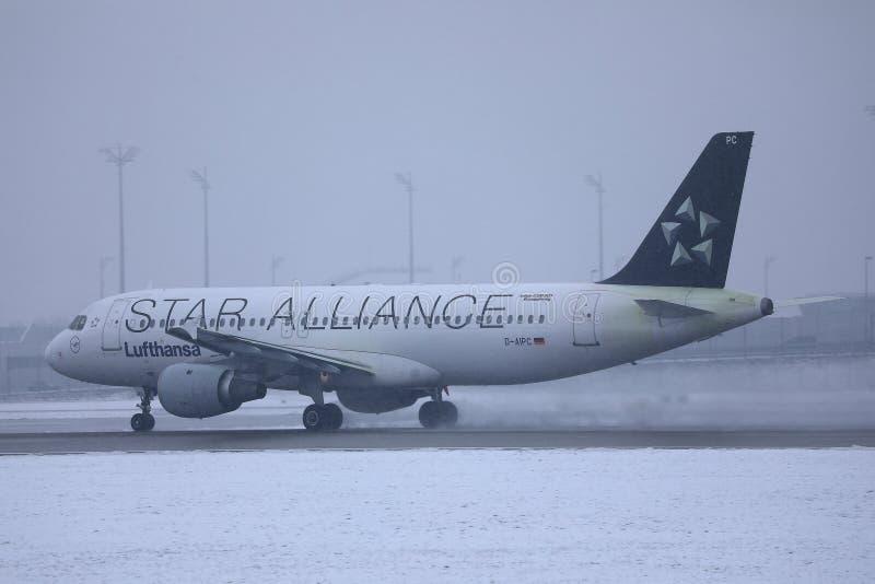 Lufthansa plane taxiing on snowy runway. Munich Airport MUC stock photo