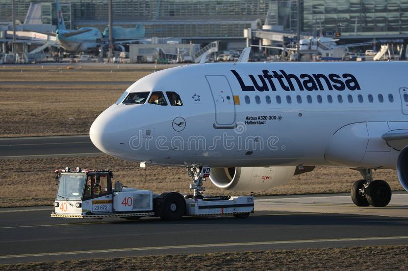 Lufthansa plane towed being in Frankfurt Airport. Lufthansa plane being taxiing in Frankfurt Airport, FRA royalty free stock photography