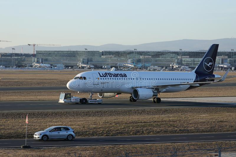 Lufthansa plane towed being in Frankfurt Airport. Lufthansa plane being taxiing in Frankfurt Airport, FRA. New livery royalty free stock image