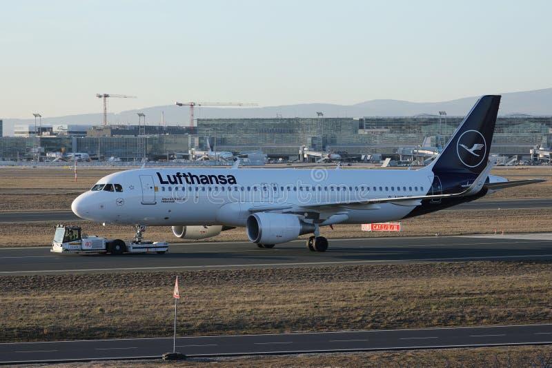 Lufthansa plane towed being in Frankfurt Airport. Lufthansa plane being taxiing in Frankfurt Airport, FRA royalty free stock image