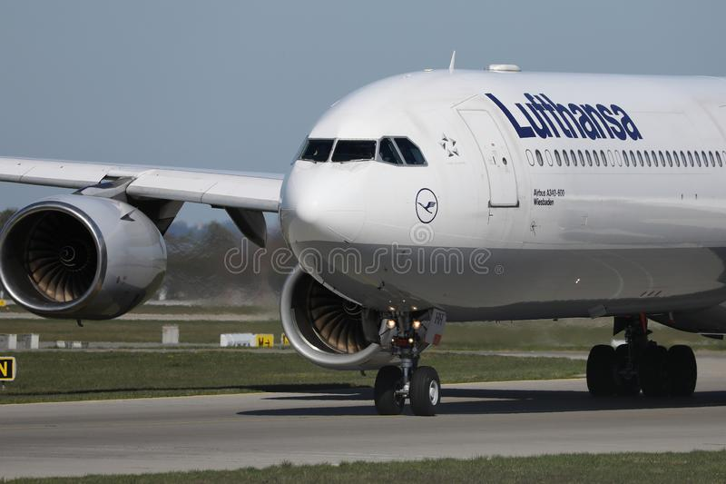 Lufthansa plane taxiing on Munich Airport, MUC, close-up view. Lufthansa planes taking off from Munich Airport MUC stock photos