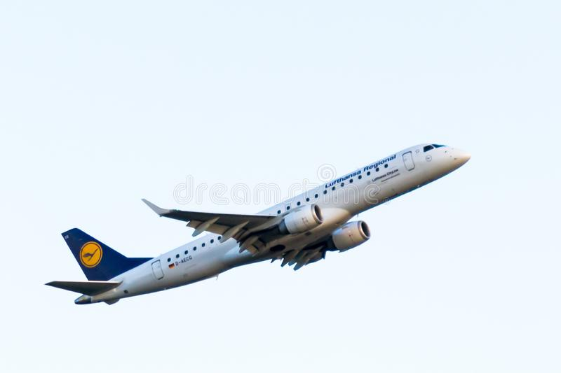 Lufthansa regional plane taking off from the airport of Cluj-Napoca. C royalty free stock photos