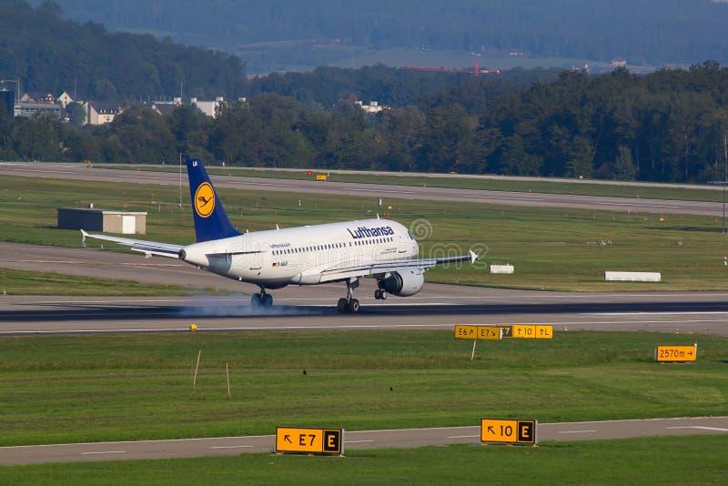 A-320 Lufthansa. ZURICH - AUGUST 23: A-320 Lufthansa landing in Zurich airport after short haul flight on July 18, 2015 in Zurich, Switzerland. Lufthansa is royalty free stock photos