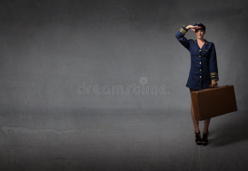 Luftkapitän in einer Militärbegrüßung lizenzfreie stockbilder