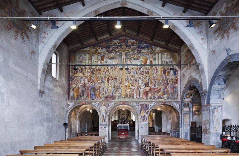 Lugano Church Inside Hall. Old historic Catholic church interior decorated on wall painting frescos day time view with nobody royalty free stock images
